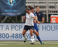 Boston Breakers midfielder Jo Dragotta (25) yellow card fouls a breaking Sky Blue FC forward Monica Ocampo (8). In a National Women's Soccer League Elite (NWSL) match, Sky Blue FC (white) defeated the Boston Breakers (blue), 3-2, at Dilboy Stadium on June 16, 2013.