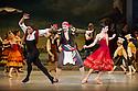 London, UK. 30.03.2013. The Mikhailovsky Ballet present DON QUIXOTE at the London Coliseum. Picture shows: Ivan Vasiliev (Basilio), Philip Parkhachov (Lorenzo) and Natalia Osipova (Kitri). © Jane Hobson.