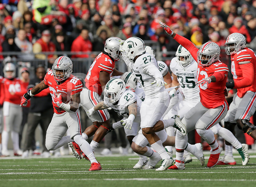 Ohio State Buckeyes running back Mike Weber (25) breaks away from the pack during the second quarter of the NCAA football game against the Michigan State Spartans at Ohio Stadium in Columbus on Nov. 11, 2017. [Adam Cairns/Dispatch]