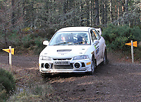 Steven Clark - Steve Pugh in a Mitsubishi Lancer Evolution 4 competing at Junction 6 on the Munro Scotch Beef Millbuie Special Stage 1 on the 2014 Arnold Clark/Thistle Hotel Snowman Rally, supported by Highland Office Equipment, part of Capital Document Solutions which was organised by Highland Car Club and based in Inverness on 22.2.14; Round 1 of the 2014 RAC MSA Scottish Rally Championship sponsored by ARR Craib Transport Limited.