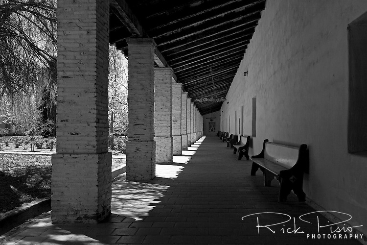 "Interior arcade surrounds the patio at Mission San Antonio de Padua. Mission San Antonio de Padua sits within the ""Valley of the Oaks"" in Monterey County near the town of Jolon. The mission was founded on July 14, 1771 by Father Junipero Serra and was the third mission in Alta California. Mission San Antonio de Padua is located on eighty pristine acres on what was once the Milpitas Unit of the Hearst Ranch and is today surrounded by the Army's Fort Hunter Ligget Military Reservation."
