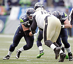 Seattle Seahawks  offensive linemen J.R. Sweezy (64) and Max Unger blocks (60)  New Orleans Saints  Junior Galette (93) and Curtis Lofton (50) during the 2nd round in a NFL Western Division playoff game at CenturyLink Field in Seattle, Washington on January 11, 2014.  Seahawks beat the Saints 22-15 to take home-field advantage in the NFL Championship Game. ©2014. Jim Bryant Photo. ALL RIGHTS RESERVED.