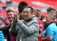 Peter Lim, one of Singapore's leading stockbrokers and an investor in Salford City applauds the fans at the end of the match during AFC Fylde vs Salford City, Vanarama National League Football Promotion Final at Wembley Stadium on 11th May 2019
