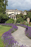 The garden of the Royal Crescent Hotel in Bath with outdoor seating and paths lined with lavender.