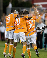 Houston Dynamo midfielder Ricardo Clark (13), midfielder Geoff Cameron (20), and defender Bobby Boswell (32) celebrate a goal. Houston Dynamo defeated Pachuca FC 2-0 in the semifinals of the Superliga 2008 tournament at Robertson Stadium in Houston, TX on July 29, 2008.