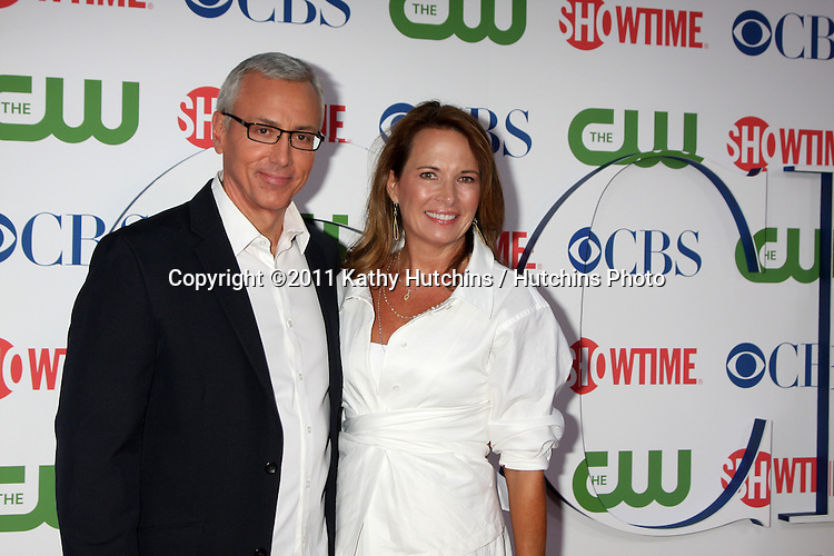 LOS ANGELES - AUG 3:  Drew Pinsky and wife arriving at the CBS TCA Summer 2011 All Star Party at Robinson May Parking Garage on August 3, 2011 in Beverly Hills, CA