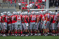 The Ohio State Buckeyes huddle up at midfield before the NCAA football game at Ohio Stadium in Columbus on Sept. 7, 2013. (Alex Holt / The Columbus Dispatch)