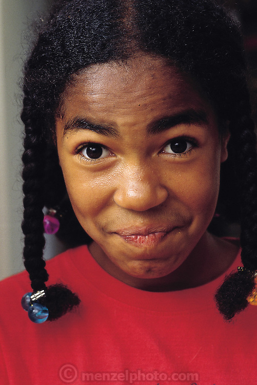 Safiya Carter-Thompson, 12, puckers up a bit after trying a chocolate-chip mealworm cookie. Berkeley, California, United States. (Man Eating Bugs page 185)