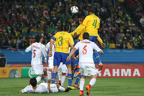JUNE 28, 2010 - Football : 2010 FIFA World Cup South Africa Round of 16 between Brazil 3-0 Chile at Ellis Park Stadium, Johannesburg, South Africa. Juan (BRAz) climbs high to head in Brazils first goal from a corner..