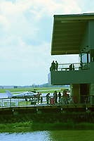 NWA Democrat-Gazette/FLIP PUTTHOFF <br />Visitors on Saturday Oct. 6 2018 take in the view from porches during the grand opening of Thaden Fieldhouse at the Bentonville airport. The fieldhouse features porches that overlook the runway, an exhibit hangar, cafe and retail shop. It is also home of the OZ1 Flying Club.