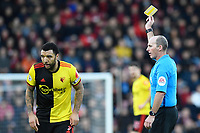 Troy Deeney of Watford gets a yellow card from Referee Mike Dean  during AFC Bournemouth vs Watford, Premier League Football at the Vitality Stadium on 12th January 2020