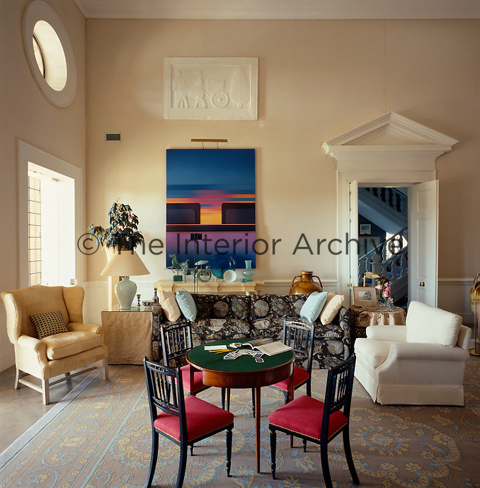 Classical architectural features are used throughout this contempory Palladian-style villa and the walls of the double-height living room have been lined with natural artist's canvas