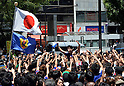 June 15, 2014, Tokyo, Japan - A huge crowd of hard-core soccer fans stage a pep rally in front of Tokyos Shibuya railroad station following Japans 1-2 loss to Ivory Coast in a world cup match on Sunday, June 15, 2014. The west African handed Japan her first defeat in their first match in the preliminary round of the 2014 FIFA World Cup in Recife, Brazil. (Photo by Natsuki Sakai/AFLO) AYF -mis-