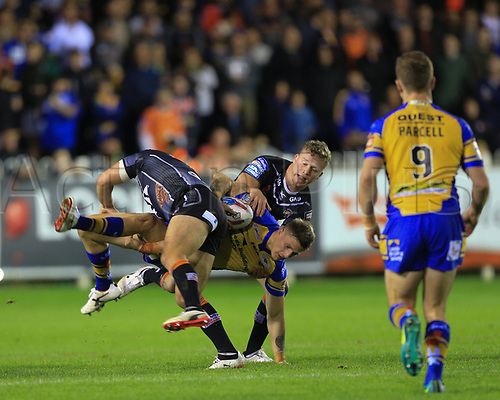 8th September 2017, The Mend-A-Hose Jungle, Castleford, England; Betfred Super League, Super 8s; Castleford Tigers versus Leeds Rhinos; Liam Sutcliffe of Leeds Rhinos is stopped by Paul McShane of Castleford Tigers and Adam Milner of Castleford Tigers