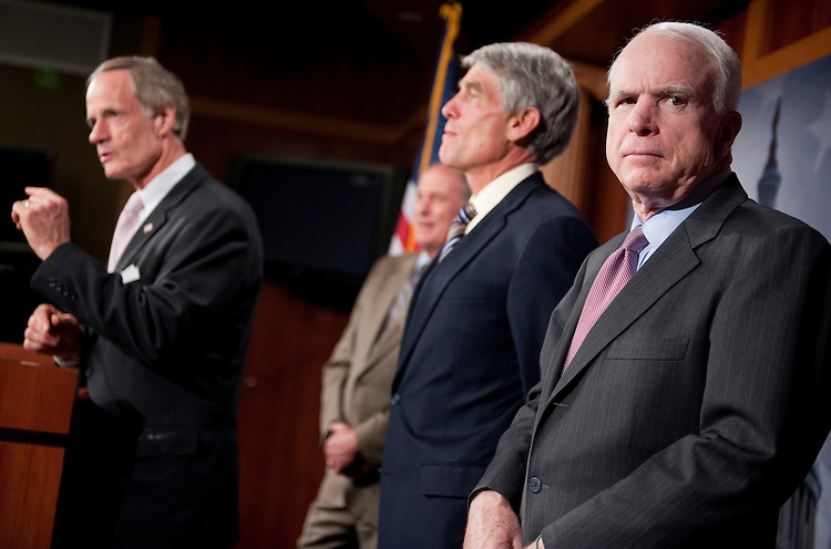 "UNITED STATES - SEPTEMBER 20:  From left Sens. Tom Carper, D-Del., Dan Coats, R-Ind., Mark Udall, D-Colo., and John McCain, R-Ariz., conduct a news conference  in the Capitol on a letter they sent to the Joint Select Committee on Deficit Reduction to urge them to give the president statutory line-item veto power to ""reduce wasteful spending.""  (Photo By Tom Williams/Roll Call)"