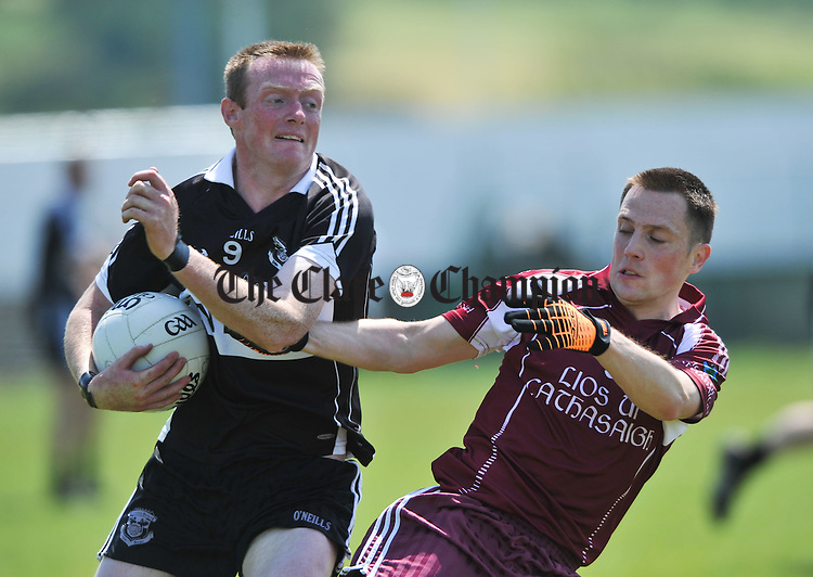Enda Doyle of Doonbeg in action against Gerry Moran of Lissycasey during their Championship meeting at Cooraclare. Photograph by John Kelly.