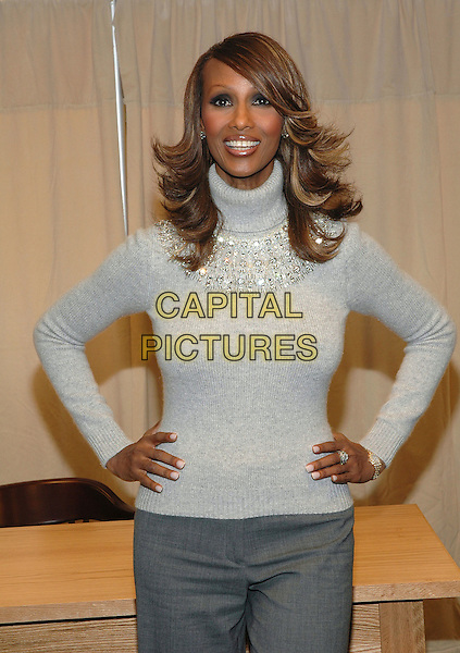 "IMAN.Signs copies of her new book, ""The Beauty Of Color"" at the Barnes & Noble Bookstore on 5th Avenue in Manhattan, New York, New York. .October 17th, 2005.Photo Credit: Patti Ouderkirk/AdMedia/Capital Pictures.Ref: PO/ADM.half length grey gray sweater turtleneck polo neck hand on hips.www.capitalpictures.com.sales@capitalpictures.com.© Capital Pictures."