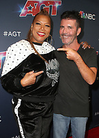 HOLLYWOOD, CA - SEPTEMBER 10: Queen Latifah and Simon Cowell at America's Got Talent Season 14 Live Show Arrivals at The Dolby Theatre in Hollywood, California on September 10, 2019. <br /> CAP/MPIFS<br /> ©MPIFS/Capital Pictures