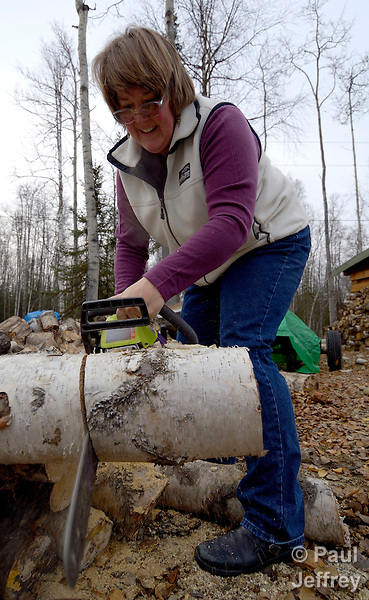 Fran Lynch in a United Methodist deaconess in Willow, Alaska, involved in a variety of ministries with people in the region. Here she cuts wood for poor families to have heat in the cold Alaskan winter.