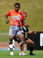 Wellington's Michael Winsauer tries to tackle Maurie Wasi..NZFC soccer  - Team Wellington v Waikato FC at Newtown Park, Wellington. Sunday, 20 December 2009. Photo: Dave Lintott/lintottphoto.co.nz