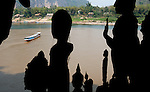 A boat carrying visitors on the Mekong River is seen from Tham Ting in Pak Ou, Laos on Thursday, March 6, 2008.  Tham Ting, which housed hundreds of Buddha figures, is considered a sacred shrine.   (photo by Khampha Bouaphanh)