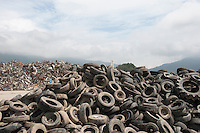 A pile of tires accumulated during reconstruction efforts following the 311 Tohoku Tsunami in Rikuzentakata, Japan  © LAN