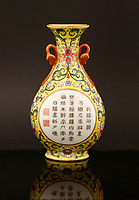 BNPS.co.uk (01202 558833)<br /> Pic: Sworders/BNPS<br /> <br /> A Chinese vase which was bought for £1 in a charity shop could sell for £80,000 because it was made for a 18th century emperor.<br /> <br /> Unaware of its significance, the shopper listed the small yellow florally decorated vase on eBay to see if it was worth anything - only to be inundated with messages and bids.<br /> <br /> Realising the pear-shaped vase, which is designed to be attached to a wall, must be valuable, he removed it from the bidding site and took it to specialists at Sworders Fine Art Auctioneers' in Stansted Mountfitchet, Essex.<br /> <br /> The 8ins Qianlong famille rose vase, found in Hertfordshire, was made around 300 years ago in China and was marked with a symbol that meant it wasn't for export, but for the Emperor's palace.<br /> <br /> It is inscribed with an imperial poem that 'praises incense' and two iron-red seal marks that read 'Qianlong chen han' or 'the Qianlong Emperor's own mark'. It also reads 'Weijing weiyi' - 'be precise, be undivided'.