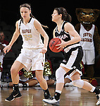SIOUX FALLS, SD - MARCH 6:  Bobbi Beckwith #24 of Omaha looks for someone to pass the ball to as Jenna Gunn #32 of IUPUI watches in the 2016 Summit League Tournament.  (Photo by Dick Carlson/Inertia)
