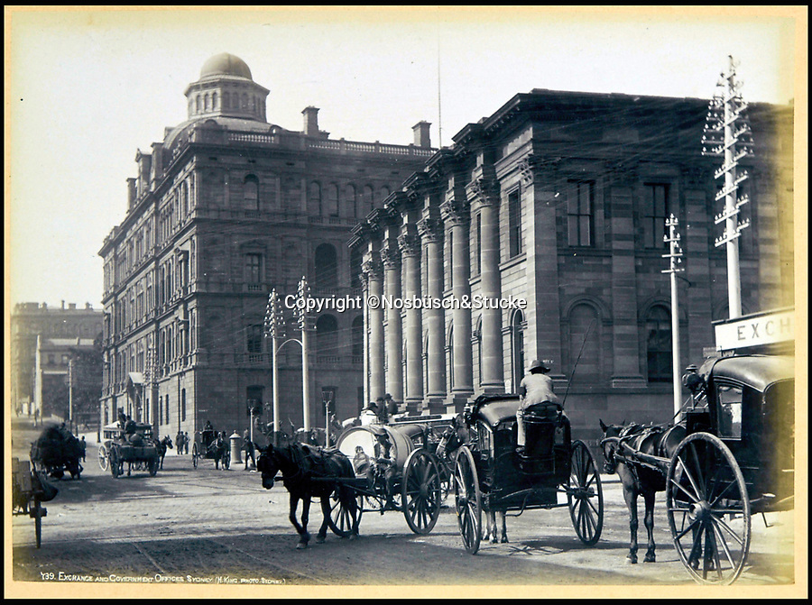 BNPS.co.uk (01202 558833)<br /> Pic: Nosbüsch&Stucke/BNPS<br /> <br /> Exchange and Government Offices, Sydney.<br /> <br /> A stunning collection of photographs of Sydney decades before the iconic harbour bridge and opera house were built has been unearthed after 129 years.<br /> <br /> The black and white photo album captures the bustling city centre, picturesque main harbour and famous beaches of the future tourist hot-spot. <br /> <br /> The photos were taken by celebrated Australian photographer Henry King in 1888 who was born in England but emigrated to Australia at a young age and spent the rest of his life there.<br /> <br /> More recently they have fallen into the hands of a German collector who has decided to put them on the market and they are tipped to sell for £1,800.<br /> <br /> Many of Sydney's most recognisable landmarks including Manly beach and Coogee bay look very different to what backpackers would encounter today.<br /> <br /> King also took various photos of Circular Quay - the city's main harbour - but missing from them are images of the Sydney Harbour Bridge and Sydney Opera House as these landmarks were both not built until well into the 20th century.