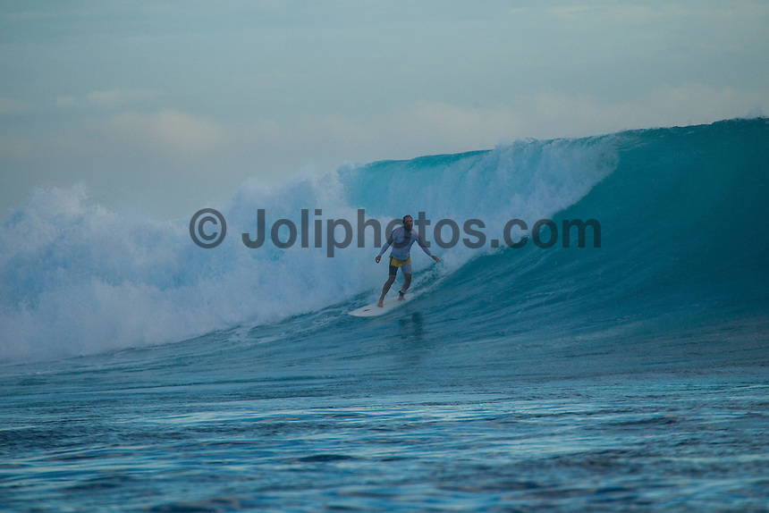 Namotu Island Resort, Fiji. (Tuesday, September 11, 2012) -  There was small  surf in the 3' + range at first light today but as the tide filled in so do the swell. By mid morning there were solid 6'- 8' sets at Cloudbreak but the wind blew it out by midday.  Around mid afternoon the wind swung back to the east and backed off for the afternoon session at Cloudbreak. The swell had built during the afternoon with 10' sets for the last two hours before dark. Photo: joliphotos.com