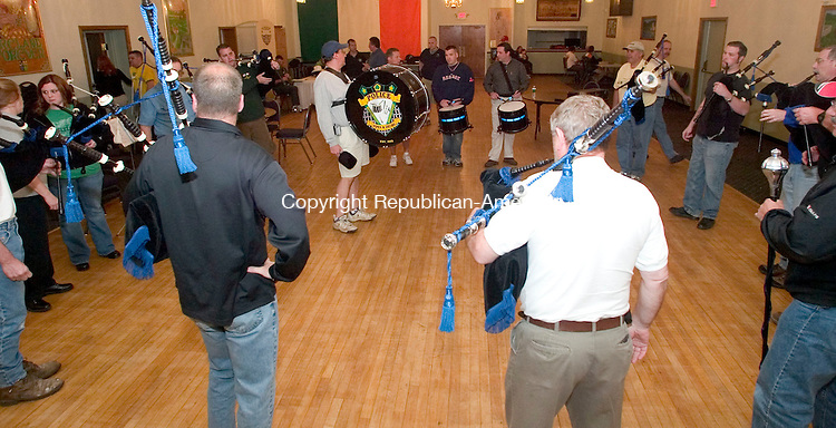 WATERBURY, CT -01 MAY 2006 -050206JT12--<br /> Waterbury Pipe and Drums rehearse at the Ancient Order of Hibernians Hall on Monday, May 1.<br /> Josalee Thrift Republican-American