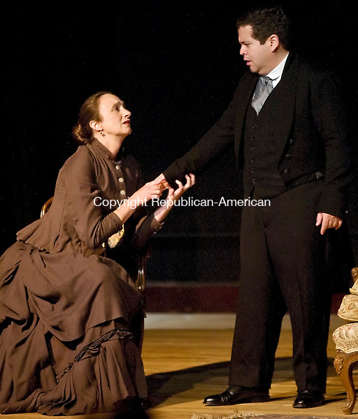 """WATERBURY--29 May 08- Hedda Gabler, played by Melora Mennesson, explains to her husband, Jorgen Tesman, played by Richard Rivas, that she burned Eilert Lovborg's manuscript to remove him as a competitor for Tesman during a performance of """"Hedda Gabler"""" at the Mattatuck Museum on Monday, May 26, 2008. (T.J. Kirkpatrick/Republican-American)"""
