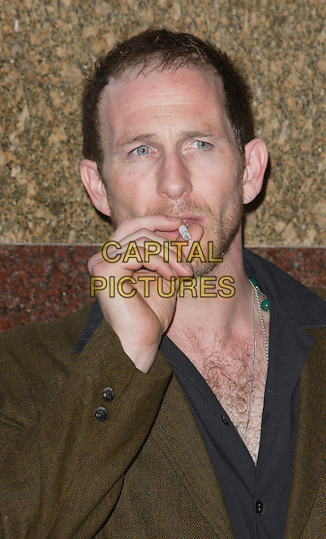 "PAUL KAYE.UK Film Premiere of ""Cass"" held at the Empire cinema , Leicester Square, London, England, July 28th 2008..portrait headshot hairy chest green brown jacket hand smoking cigarette .CAP/ROS.©Steve Ross/Capital Pictures"