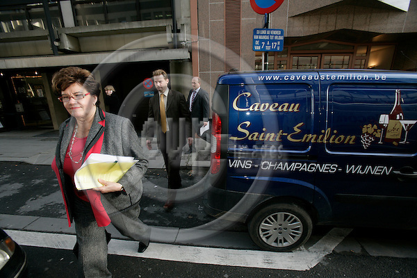 BRUSSELS - BELGIUM - 22 NOVEMBER 2007 --  Sirkka-Liisa ANTTILA, Finnish Minister for Agriculture passing a van advertising for wine and a restaurant, after her meeting with the Commissioner for Agriculture. Following behind, her State Secretary Jouni LIND.  Photo: Erik Luntang/EUP-IMAGES/