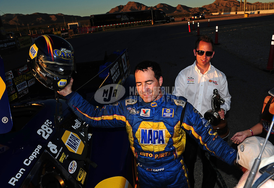 Oct. 30, 2011; Las Vegas, NV, USA: NHRA funny car driver Ron Capps celebrates after winning the Big O Tires Nationals at The Strip at Las Vegas Motor Speedway. Mandatory Credit: Mark J. Rebilas-