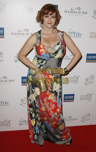 SARA RUE .Lili Claire Foundation Benefit Dinner and Concert featuring the Goo Goo Dolls, Sugar Ray, and Josh Kelly held at Mandalay Bay Hotel and Casino, Las Vegas, Nevada, USA, 26 April, 2008..full length print patterned maxi dress hands on hips gold earrings .CAP/ADM/MJT.©MJT/Admedia/Capital Pictures