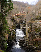 Pic shows the new Bracklinn Falls Bridge, near Callander, which opens tomorrow (Tues 16th). The popular walking spot at Bracklinn Falls has been without a bridge since flash floods washed away the original bridge in 2004. Loch Lomond & The Trossachs National Park has worked with Callander Community Development Trust to replace the bridge. The rural location of the site made it impossible to use traditional installations methods including crane and helicopter options. A team of two contractors had to winch the 20 metre steel and timber structure into place by hand. The bridge has a distinct copper roof and is designed using locally sourced Larch and four Douglas Fir tree trunks each measuring 12 metres long. It weighs 20 tonnes and took over 3,000 man hours to install, at a cost of £110,000. Project Manager Kenny Auld (in some pics) is on 07740073286 - picture by Donald MacLeod 15.11.10 - mobile 07702 319 738 - clanmacleod@btinternet.com - www.donald-macleod.com