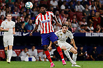 Thomas Teye of Atletico de Madrid and Fede Valverde  of Real Madrid during La Liga match between Atletico de Madrid and Real Madrid at Wanda Metropolitano Stadium{ in Madrid, Spain. {iptcmonthname} 28, 2019. (ALTERPHOTOS/A. Perez Meca)