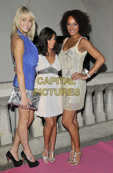 Melissa Walton, Hayley Tamaddon & Tupele Dorgu.attended the Inspiration Awards For Women, Cadogan Hall, Sloane Terrace, London, England, UK, October 7th 2011..full length peach blue grey gray white dress blue halterneck cowel   silver sandals gold beaded sequined sequin .CAP/CAN.©Can Nguyen/Capital Pictures.