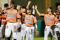 Jerry Owens, Luis Borguez y Jesse Gutierrez  festejan triunfo de naranjeros , durante el juego a beisbol de Naranjeros vs Cañeros durante la primera serie de la Liga Mexicana del Pac