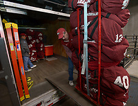 NWA Democrat-Gazette/ANDY SHUPE<br />Jerry Rico (right) of Fayetteville loads a stack of players' equipment with the help of Rodney Collins of Pensacola, Fla., Thursday, Nov. 9, 2017, into a 53-foot semi-trailer before heading out to Baton Rouge, La., ahead of the Razorbacks' game with LSU Saturday. Rico and Collins are employees of J.B. Hunt Transport and the work together to drive equipment necessary for the Razorbacks football team to and from games away from Fayetteville.