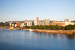 The view of the downtown Portland, Oregon and Tom McCall Waterfront park from the Burnside Bridge at sunrise.