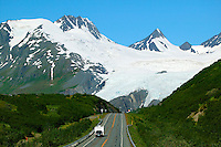 The RV's on the Richardson Highway travel through the Chugach Mountains and Chugach National Forest as it passes over Thompson Pass on the way to Valdez, Alaska.