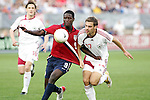 28 May 2006: U.S. forward Eddie Johnson (9) has his jersey pulled by Latvia's Oskars Klava (17) as he goes for the ball. The United States Men's National Team defeated Latvia 1-0 at Rentschler Field in East Hartfort, Connecticut in an international friendly soccer match.
