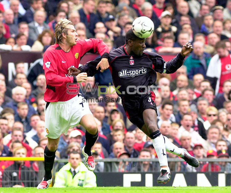 Pix:BEN DUFFY/SWpix.com. Barclaycard Premiership Football- Man chester United v Charlton Athletic ......03/05/2003...COPYRIGHT PICTURE>>SIMONWILKINSON>>01943 436649>>..Manchester United's David Beckham and Charlton's Chris Powell challenge for posession