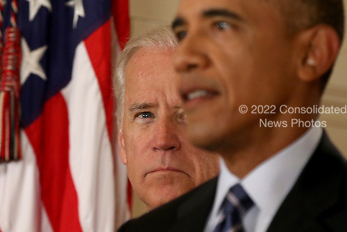 United States Vice President Joe Biden listens as US President Barack Obama delivers remarks in the East Room of the White House in Washington, Tuesday, July 14, 2015, after an Iran nuclear deal is reached. After 18 days of intense and often fractious negotiation, diplomats Tuesday declared that world powers and Iran had struck a landmark deal to curb Iran's nuclear program in exchange for billions of dollars in relief from international sanctions.<br /> Credit: Andrew Harnik / Pool via CNP