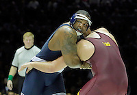 STATE COLLEGE, PA - JANUARY 25: Michael Kroells of the Minnesota Golden Gophers and Jimmy Lawson of the Penn State Nittany Lions during their match on January 25, 2015 at Recreation Hall on the campus of Penn State University in State College, Pennsylvania. Minnesota won 17-16. (Photo by Hunter Martin/Getty Images) *** Local Caption *** Michael Korells;Jimmy Lawson