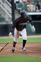 Alexander Simon (23) of the Kannapolis Intimidators starts down the first base line against the Lakewood BlueClaws at Intimidators Stadium on July 14, 2015 in Kannapolis, North Carolina.  The Intimidators defeated the BlueClaws 8-2.  (Brian Westerholt/Four Seam Images)
