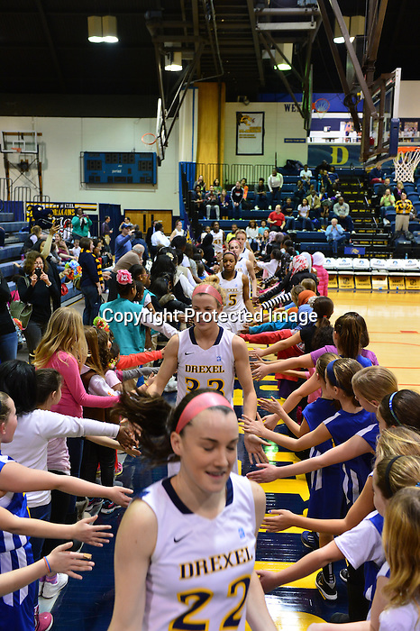PHILADELPHIA - The Drexel women's basketball team came up short in its bid to sweep a three-game conference homestand as the Dragons fell to Hofstra on Sunday, 68-66. The loss was the first at home for Drexel in conference play. The two teams were tied 11 times and exchanged leads 15 times during the course of the action, with Hofstra getting the go-ahead bucket with 8.4 seconds to play.<br /> <br /> Meghan Creighton put up a season-high 18 points for the Dragons (10-10, 5-2). She was 5-of-10 from long range, adding five rebounds and three assists. Fiona Flanagan scored 12, all of which came in the second half. Twice, she nailed three-pointers that broke tie scores. Abby Redick also had a big three-pointer late, finishing with 11 points. Annie Payton of Hofstra (9-10, 4-4) led all scorers with 21. Kelly Loftus finished with 14 points and 10 rebounds for a double-double.<br /> <br /> The Dragons overcame an early 14-point deficit, and the game remained close throughout after that point. Hofstra hit seven of its first eight field goal attempts to build a 20-6 lead with 15:02 remaining in the first half, but the Dragons' league-leading defense stepped up from there, allowing them just one field goal over the next 13:36. Drexel took the lead back at 25-22 with 5:52 to play when Creighton buried a three-pointer to cap a 19-2 run.<br /> <br /> Hofstra stayed in the game thanks to free throw shooting, going 8-for-8 from the line during the 13:36-long cold spell. The Pride finished the afternoon 16-of-19 from the charity stripe overall. At the break, the teams were tied at 34.<br /> <br /> Things remained tight in the second half, with neither team able to build more than a three-point cushion until Fiona Flanagan broke a 49-49 tie with a three-pointer, following it with a short jumper that gave the Dragons a five-point lead with 8:36 to play. That would prove to be their largest lead of the day, and the only multi-possession edge for either team in the second half.
