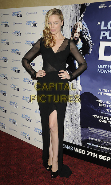 MELISSA GEORGE.UK premiere of 'A Lonely Place To Die' at Empire Leicester Square, London, England. .September 7th, 2011.full length black dress sheer sleeves slit split hands on hips.CAP/CAN.©Can Nguyen/Capital Pictures.